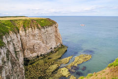 Cliffs at Flamborough Head with boat in distance Royalty Free Stock Photo