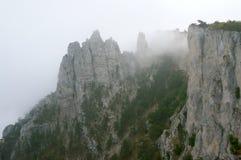 Cliffs in fog Stock Image