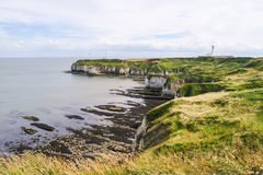 Cliffs, foreshore and lighthouse at Flamborough Head Royalty Free Stock Photos