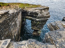 Cliffs at Fowl Craig, Papa Westray, Orkney. View from high, rugged cliffs looking out over the North Sea Royalty Free Stock Photography