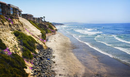 Cliffs, Homes, Beach, and Ocean, California. Residentail buildings, mostly condominiums, are precariously built on eroding cliffs, strengthened and reinforced Royalty Free Stock Images