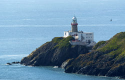 Cliffs in Howth and lighthouse Stock Photo
