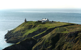 Cliffs In Howth And Lighthouse Royalty Free Stock Photo