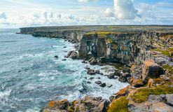 The cliffs of Inishmore, Aran Islands, Ireland. Inishmore is one of western Ireland`s Aran Islands. It sits at the mouth of Galway Bay and is known for ancient Royalty Free Stock Photography