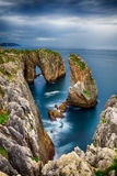 Cliffs and islets in the Cantabrian coast. Formation of islets and rocks due to the erosion of the sea on the cliffs Royalty Free Stock Photos