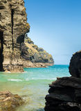 Cliffs jutting into the ocean from Bossiney Haven cove, Cornwall Stock Image