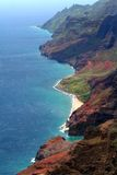 Cliffs of Kauai. Aerial view of cliffs on the island of Kauai, aqua water, rocky cliffs with some vegetation, there is a small sandy beach Royalty Free Stock Photos