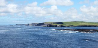 Cliffs of Kilkee. In county Clare in Ireland Stock Photos