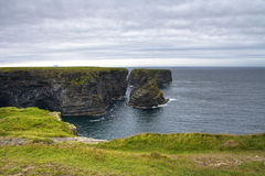 Cliffs in Kilkee, Ireland Stock Photos