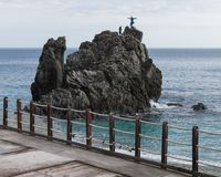 Boys play to photograph on the rock of Monterosso royalty free stock images
