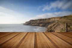 Cliffs landscape stretching out to sea with wooden planks floor Stock Image