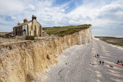 The cliffs and lighthouse at Beachy Head on the south coast of England. Stock Photos