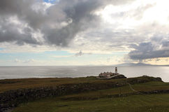 Cliffs and lighthouse, scotland Royalty Free Stock Image