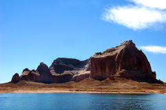 Cliffs line shore of Lake Powell Stock Photos