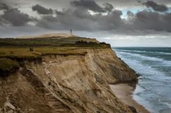 Cliffs in Lonstrup, Rubjerg Knude lighthouse on a dune in the background, north Jutland, Denmark stock photos