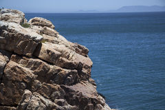 Cliffs looking over False bay, Cape Town. With a beautiful blue sky and sea Stock Photography