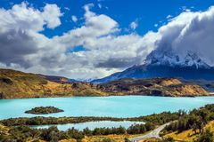 The cliffs of Los Cuernos. Torres del Paine National Park. The magnificent cliffs of Los Cuernos are covered with snow. Summer in the south of Chile. The concept stock image
