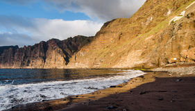 Cliffs of Los Gigantes at sunset Royalty Free Stock Images