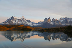 Cliffs of Los Kuernos reflection during sunrise at Lake Pehoe in National Park Torres del Paine Royalty Free Stock Image