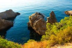 Cliffs in mediterranean sea in coast of Lloret de Mar, Costa Brava, Spain. Scenic view on sea in rocky coastline royalty free stock photo