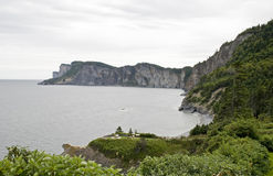 Cliffs meet ocean in Gaspe Stock Photos