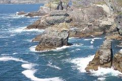 Cliffs at Mizen Head Penninsula West Cork Ireland. Atlantic Blue Water and Cliffs at Mizen Head Penninsula West Cork Ireland Royalty Free Stock Photos