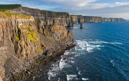 Cliffs of Moher. Picture taken of the famous rock walls of the Cliffs of Moher on the west coast of Ireland at sunset Stock Photos