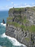 Cliffs of Moher. View from Cliffs of Moher, in the West Ireland, with a tiny Tower on top Royalty Free Stock Photography