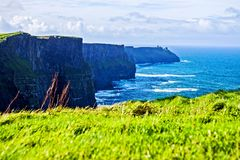 Cliffs of Moher at Alantic Ocean in Western Ireland with waves battering against the rocks stock images