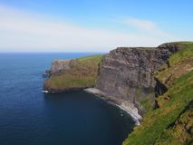 Cliffs of Moher. The beautiful Cliffs of Moher with lovely blue sea and sky in western Ireland Stock Image