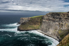 Cliffs of Moher,Clare,Ireland. Scenic contrast view of seashore cliffs in sunny day Stock Image