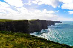 Cliffs of Moher Doolin Ireland Irish famous sightseeing cliff atlantiv ocean hiking scenic coastline. Cliffs of Moher Doolin Ireland Irish famous sightseeing stock image
