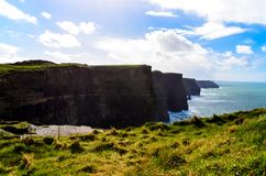 Cliffs of Moher Doolin Ireland Irish famous sightseeing cliff atlantiv ocean hiking scenic coastline. Coast stock images
