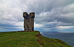 Cliffs of Moher at Hags Head under brooding skies Royalty Free Stock Photo