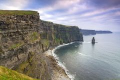 Cliffs of Moher in Ireland. At cloudy day, Co. Clare Royalty Free Stock Images
