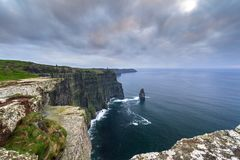 Cliffs of Moher in Ireland. At cloudy day, Co. Clare Stock Photo