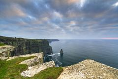 Cliffs of Moher in Ireland. At cloudy day, Co. Clare Royalty Free Stock Photo