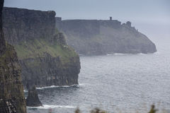 The cliffs of Moher. Cliffs of Moher in Ireland in a cloudy day Royalty Free Stock Photo