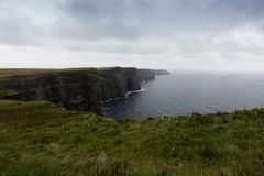 The cliffs of Moher. Cliffs of Moher in Ireland in a cloudy day Royalty Free Stock Photography