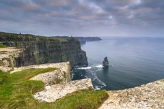Cliffs of Moher in Ireland. At cloudy day, Co. Clare Stock Photos