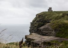 The cliffs of Moher. Cliffs of Moher in Ireland and O& x27; Brien tower Royalty Free Stock Photo