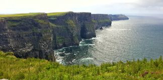 Cliffs of moher. Ireland sea ocean water cliff huge tall high danger dangerous nature amazing sky panorama panoramic island vacation tourist travel traveler Royalty Free Stock Photography
