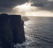 Cliffs of Moher, Ireland. Cliffs of Moher in Ireland at sunset, shot counter light Stock Photo
