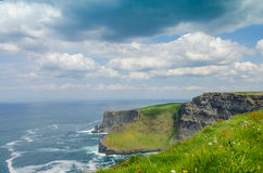 Cliffs of Moher. The Cliffs of Moher are located in the parish of Liscannor at the south-western edge of the Burren area near Doolin, which is located in County Stock Photos