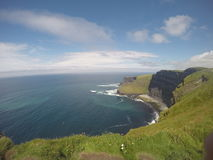 Cliffs of Moher. The Cliffs of Moher are located at the southwestern edge of the Burren region in County Clare, Ireland. They rise 120 metres above the Atlantic Royalty Free Stock Photos