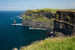 Cliffs of Moher, North Ireland sea coastline, sunny summer landscape Stock Photos