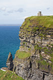 Cliffs of Moher and O'Brien's Tower. Cliffs of Moher with the O'Brien's Tower on the back Stock Photography