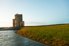 Cliffs of Moher - O Briens Tower in Co. Clare Ireland. Cliffs of Moher at sunset - O Briens Tower in Co. Clare Ireland Europe Stock Photo