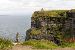Cliffs of Moher OBriens Tower. Spectacular, sheer scenic Cliffs of Moher and OBriens Tower, two popular tourist attractions on the west coast of Ireland, County Royalty Free Stock Images