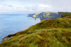 Cliffs of Moher and OBriens Tower Ireland. Beautiful landscape at the famous Cliffs of Moher and  O`Brien`s Tower in Co. Clare, Europe, ireland Royalty Free Stock Photos